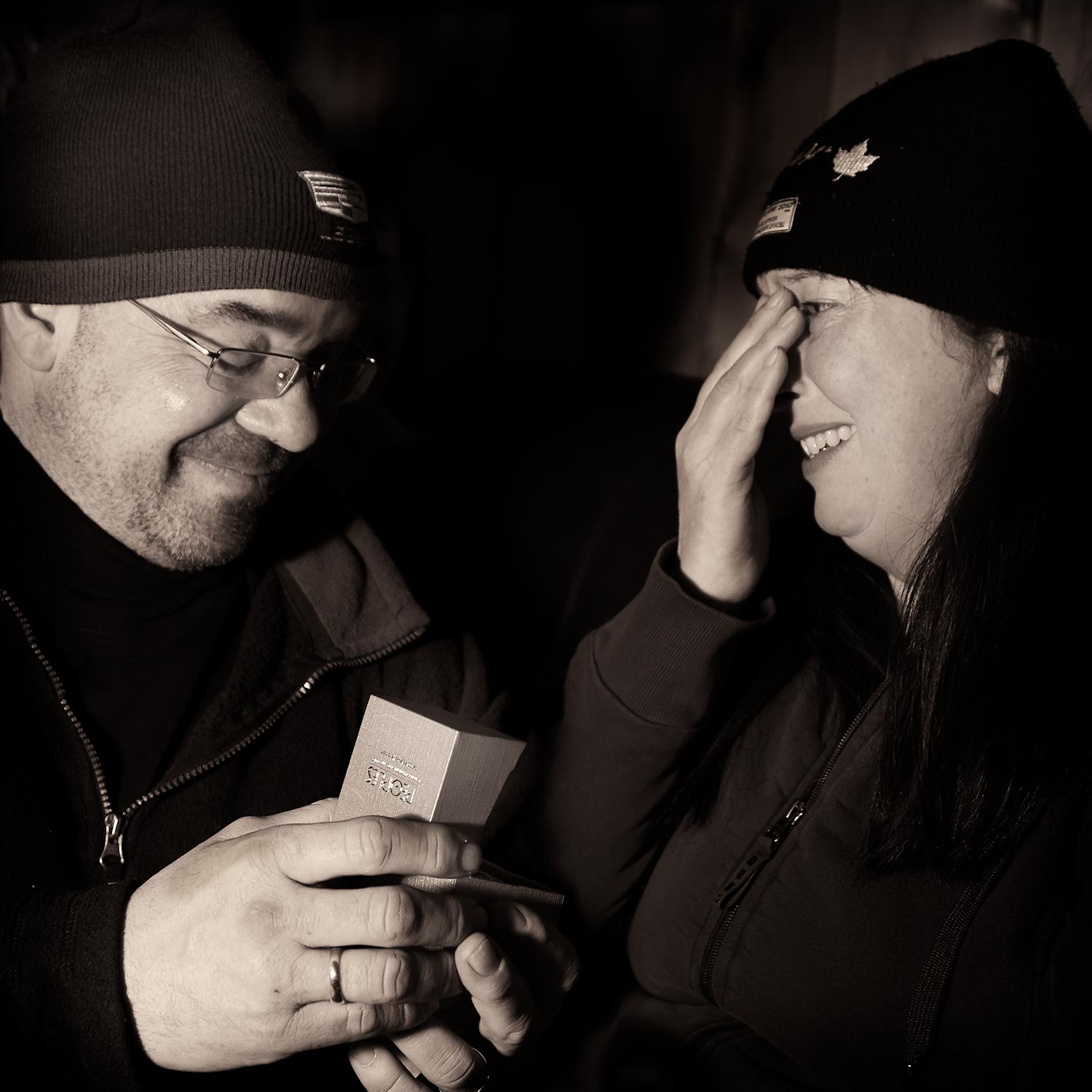 Man offering ring, proposing woman to marry him.