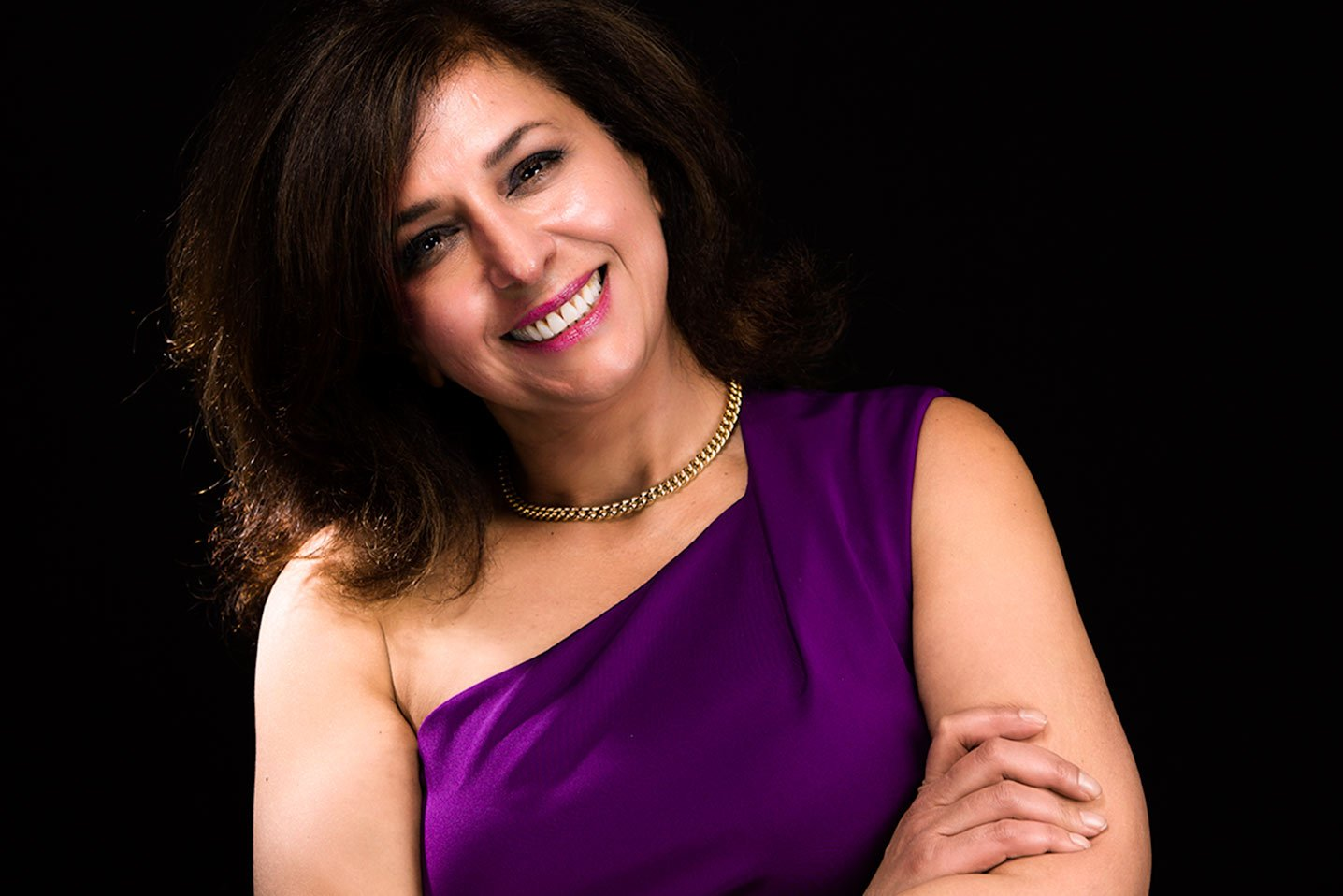 Smiling woman in purple dress