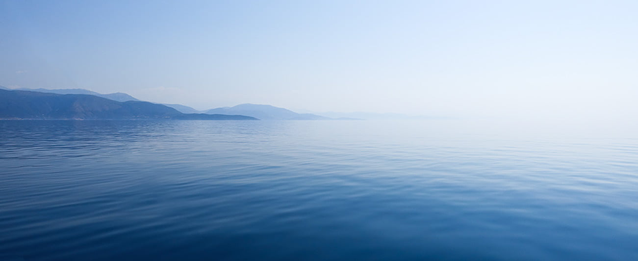Blue calm sea in while sailing in Greece